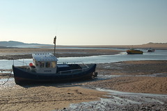 Tide's Out At Ravenglass (Travelling Man Photos) Tags: sunlight man travelling beach boats spring fishing quiet photos tide lakedistrict nikond50 aground emptiness moored ravenglass travellingmanphotos