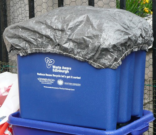Recycling container with a shower-cap