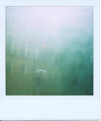 Disappearing // A Short Story // 2 of 4 (Lady Vervaine) Tags: street city uk windows light red england urban white mist london film window rain misty mystery umbrella polaroid sx70 person trafficlight flickr humanity britain ghost story human stop rainy receding mysterious haunting stoplight delicate ghostly vanishing narrative nonfiction haunt disappearance absence disappear vanish transience transient palabra disappearing sx70blend basedontrueevents