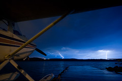 Electricity!   (View Large!) (Jason Pineau) Tags: lighting sky storm rain night clouds dark airplane nt aircraft aviation nwt bolt thunderstorm northwestterritories thunder seaplane cessna yellowknife floatplane c185 cgxrn