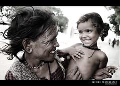 real happiness... isn't it? (Smevin Paul - Thrisookaran !! www.smevin.com) Tags: street india love church girl smile smiling paul photography kid child near daughter mother laugh tamil tamilnadu begger nadu sincere velankanni effection smevin d40x platinumheartawards malayalikoottam smevins thrisookaran