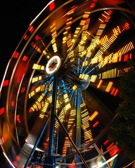 Carnival: Big Wheel (StGrundy) Tags: longexposure carnival blue atlanta red motion black color yellow night georgia lights lowlight nikon nightshot south spin roswell southern exposition ferriswheel rides bigwheel amusements d80 expowheel colorphotoaward superfaveme superhearts peachtreerides artlegacy tophonorphotographerparadise platinumheartawardshalloffame nikonflickrawardgold5