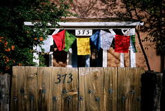 373 garcia street (davidteter) Tags: newmexico santafe film flags olympusxa2 kodakportra160vc tibetanprayerflags