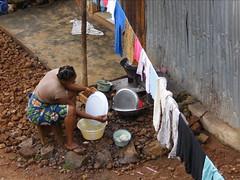 Mariama Washes Dishes 1 (Karen Hlynsky) Tags: sierraleone westafrica freetown colefarm