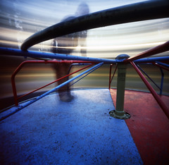 stop this ride; i want to get off (manyfires) Tags: longexposure blue selfportrait blur film me playground oregon self portland spin stjohns pinhole sigh pdx merrygoround frontpage zero2000 zeroimage fujivelvia palabra 500px itspastmybedtime ybsjan09 holcon