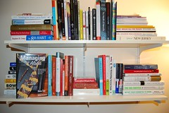 arranging books on the shelf