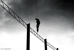 Suicide (ezreen.photography) Tags: sky bw cloud white black building silhouette dead death climb site construction asia flickr kill die crane labor suicide safety beam malaysia hanging worker hang zigzag bnw morder