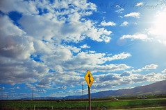 Up above the world so high (Sandeep K Bhat) Tags: california road blue sky sun sign clouds nikon 101 freeway asilomar merge formations d90
