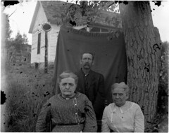 Man and two women near house (Douglas County History Research Center) Tags: house man history whatevertheweather women archive blanket scanned archives oldphotographs oldpictures everything oldphotos dcl anything vintagephotos antiquephotos flickritis norules archivists glassplatenegative historicandoldphotos anythingeverything anythingallowed antiquephotographs glassnegatives thebiggestgroup anythingandeverything 1millionphotos 10millionphotos scannedphotographs themostphotos tenmillionphotos thewholecaboodle fadedphotographs douglascountylibraries 5millionphotos historicimage douglascountyhistoryresearchcenter archivesonflickr onemillionphotos douglascountyhistoricalsociety dchrc archivesandarchivists theanythinggroup allyoulike bwfoundphotos 100000000flickrphotos fivemillionphotos 19920010xxx0g15