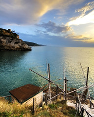 Trabucco with Monte Pucci Tower at the Back (mercolino) Tags: sunset italy coast fishing tramonto foggia peschici trabucco aplusphoto ashotadayorso montepucci