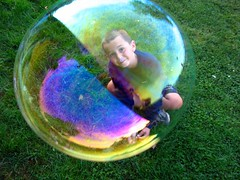 Boy in the bubble (icolorinthelines) Tags: bubble jar capturerochester