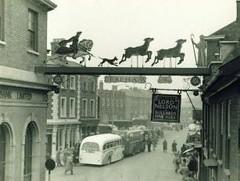 Dereham Town Sign in 1956 (SueWalkerWhite) Tags: old uk bus vintage postcard norfolk 1956 townsign dereham lordnelsonpub
