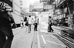 Salesmen in Mong Kok (Chemophilic) Tags: blackandwhite hongkong kodak 400tx diafine  bessal  15mmheliar  nikoncoolscanv trixstreetlifehong