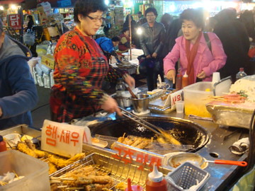 old korean woman,woman selling fried food,15 hours working a day in 35 years