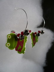 holly jolly earrings (swingin' yuletoad) (giolou) Tags: christmas winter silly tree cute animals metal shop festive beads graphics holidays forsale handmade crafts seasonal humor jewelry frog plastic toad characters earrings etsy dangle anthropomorphic shrinkydink jinglebells yuletime shrinkart anthropomorphco hollyjollies yuletoad yearofholidays