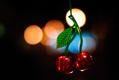 Cherry bokeh (SurfaceSpotting) Tags: red color colour colors fruit night dark cherry 50mm cherries nikon colours dof bokeh f18 d40 michaelides cherrylicious bokehlicious d40x surfacespotting georgemichaelides