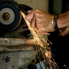 Grinding (Vermont Lenses) Tags: wheel shop work hand bracelet axe ax sparks tool carpentry grinding 500x500 worldbest