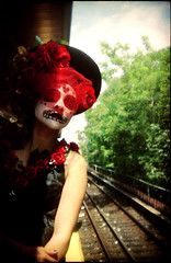 Death Train to Coney (pixietart) Tags: nyc roses portrait film hat nycpb brooklyn train 35mm dayofthedead death holga waiting veil gothic shuttle mta gothamist prospectheights mermaidparade facepaint alita parkplace holga135 dayofthedeadsea coneyislandmermaidday