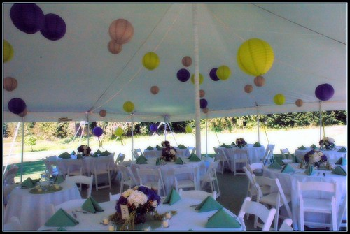The tent was decorated with paper lanterns in the wedding colors