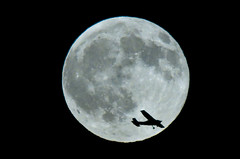 Solo Night Flight against Full Moon (Kadath) Tags: shadow moon plane airplane nikon nj august luna fullmoon vivitar silhoutte 08 lightroom oneinamillion d300 navesink notphotoshop nikond300 vivitar400mm 16august2008