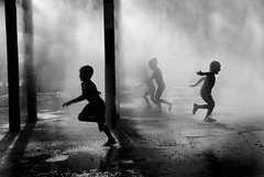 run (Rick Elkins) Tags: newyorkcity boy summer bw mist newyork wet water girl silhouette fog brooklyn children blackwhite bravo play running run spray firstquality mywinners artlibre platinumphoto anawesomeshot aplusphoto artlibres multimegashot rickelkins