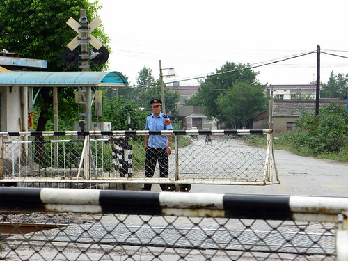 Ah the joys of cheap copious labour - two people per crossing to push the barriers across by hand (near Wuhu, Anhui Province, China)