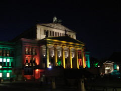 The Berlin Opera House lit up in yellow, red, ...