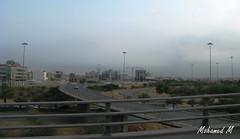 A View of Riyadh... (-Mohamed-) Tags: city sky urban tower glass skyscraper al noir cloudy kingdom ciel saudi arabia nuage riyadh moder riyad nuageux urbanisation nakheel arabie anoud saoudite