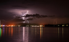 Getting Closer (ImageBud) Tags: city longexposure lake storm reflection water weather night marina canon dark newcastle town australia lightning thunder lakemacquarie 40d impressedbeauty blacksmithsbeach camdub