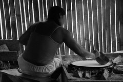 Villager making Flatbread from Yuca