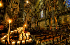 A Votive in the Dark Cathedral (Stuck in Customs) Tags: travel panorama france church glass colors beautiful lines saint statue architecture composition dark french religious photography intense nikon candles shoot catholic candle photographer gloomy shot angle cathedral image lyon god spirit unique background details prayer religion pray jesus gothic d2x perspective picture stained altar adventure edge processing sacred pro forboding framing top100 melancholy piece capture spiritual pew sculptures hdr tutorial votive treatment peacefull travelphotography hdrtutorial stuckincustoms treyratcliff