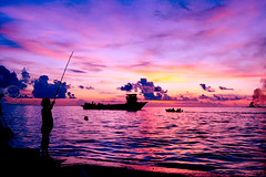 For some, the sun rises only to set... (sharaff) Tags: new trip pink blue friends light sunset sea vacation music holiday art me nature colors girl sunrise fun boats israel google fishing aperture nikon wideangle hobby leisure maldives d300 shoken sharaf sharaff flickrmessedupthecolorsagain