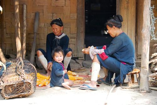 village family de-kerneling corn, luang nam tha