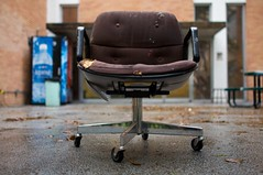 chair in the rain (xgray) Tags: brown wet rain digital upload canon austin outside prime book chair university published texas rental universityoftexas iphoto 24mm artbuilding blurb buyit chairbook ordernow ef24mmf14l xgray ef24mmf14lusm canoneos40d borrowlensescom postedtophotographersonlj ownapieceofxgray chairsbystephenmgray