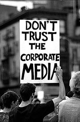Image of Don't Trust The Corporate Media sign