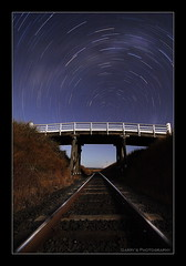 Railway to Heaven - Star Trails (Garry - www.visionandimagination.com) Tags: longexposure reflection geometric night stars landscape photography flickr track nocturnal nightshot oz photographers overpass railway australia southerncross pole explore vision queensland getty astronomy aus skyatnight qr circular garry gettyimages celestial startrails tonal moonshine milkyway stockphotography startrail queenslandrail nightimage interestingness6 abigfave southcelestialpole 52min auselite bestofaustralia geometrictonalvision theperfectphotographer railwaytoheaven visionandimaginationcom visionandimagination wwwvisionandimaginationcom