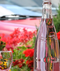 badoit (jenny downing) Tags: flowers red distortion france reflection water glass car bottle cool shiny bokeh blurred bottledwater refraction condensation evian geraniums refreshing waterbottle marigolds chilled redcar infrance badoit jennypics takeninfrance jennydowning gotredinit photobyjennydowning