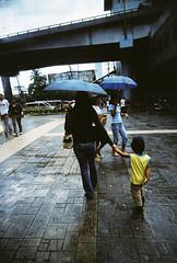 mummy dearest (joy_sale) Tags: june 2008 june2008 lomo lomography vivitar ultrawide slim vivitarultrawideslim vuws lucky200 mother son kid little boy child rain rainydays umbrella