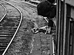 Clean-handed (noelboss) Tags: travel bw woman white black water train child journey srilanka noelboss