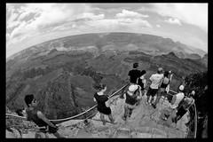 Sight-Seeing at Grand Canyon (Daniel Driensky) Tags: arizona people blackandwhite bw canon grandcanyon sightseeing grand canyon tourists fisheye tmax400 15mm 1n