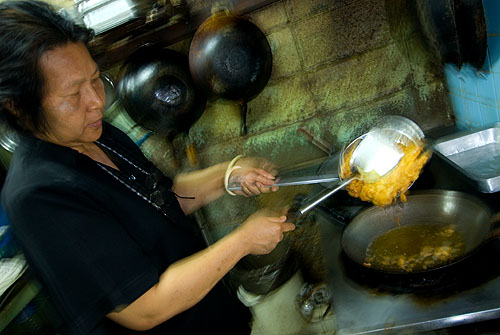 Natthamon Jaidet making a lemongrass omelet at her Bangkok restaurant, Poj Spa Kar