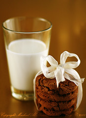 Milk & Cookies. (Mashael Al-Shuwayer) Tags: food cup cookies digital canon eos milk chocolate 85mm cadbury saudi arabia sweets saudiarabia luxury alkhobar 400d mashael alshuwayer
