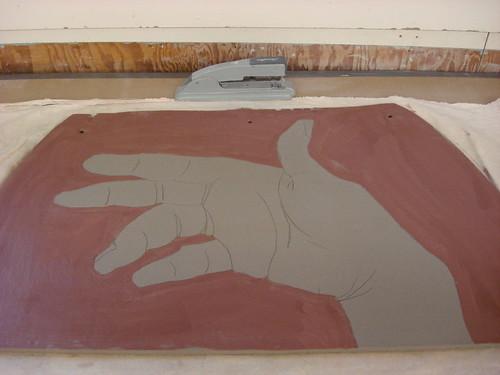 hand and stapler