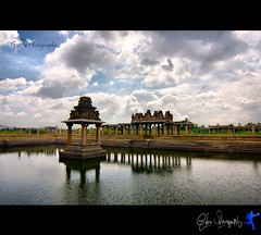 Over The Hills And Far Away (Gulfu) Tags: sky lake reflection love architecture canon pond cloudy feel tokina lonely karnataka 1224mm oldbuilding hampi prasanth oldpond overthehillsandfaraway kadhal 1000d gulfuin gulfuphotography