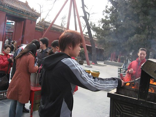Beijing Lama Temple - People lighting incense sticks