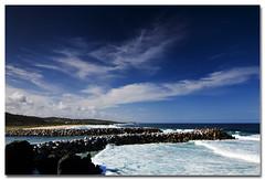 Wagonga Head (The Sage of Shadowdale) Tags: ocean sea sky beach water clouds d50 rocks waves australia tokina pacificocean nsw breakwall narooma 1224mmf4 eurobodalla wagongahead
