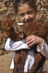 Having fun with a baby goat (: (Izla Kaya Bardavid) Tags: girls summer portrait people color cute smile face smiling animal kids turkey children happy photo spring village child sheep faces joy mesopotamia peole turabdin assyrian syriac ilovegoats allaboutpeople southeastturkey nikonphoto