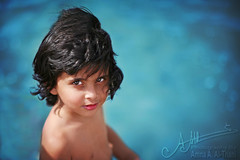 His Piercing Gaze ,, (A.A.A) Tags: blue boy portrait cute eye beach face look hair photography eyes child m photograph sh gaze fahad aaa qatar amna irresistible althani amnaaalthani hawaalrayyanfav photographybyamnaaalthani