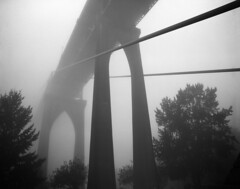 St Johns Bridge, one foggy morning (Zeb Andrews) Tags: bridge bw fog architecture oregon portland gray foggy mysterious pacificnorthwest pdx fujineopan400 stjohnsbridge suspensionbridges pentax6x7 bluemooncamera historicbridges zebandrews kodakxtol zebandrewsphotography