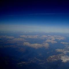 Holga-esque aerial shot ('Piers Plowman') Tags: blue sky mountains alps clouds aerial holgaesque darkedges